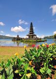 A Floating Temple With Flowers. Bedugul is a mountain lake resort area in Bali, Indonesia, located in the centre-north region of the island near Lake Bratan on royalty free stock image