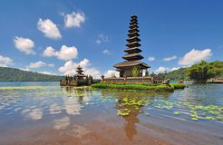 A Floating Temple With Flowers. Bedugul is a mountain lake resort area in Bali, Indonesia, located in the centre-north region of the island near Lake Bratan on stock photo