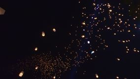 Floating thousands lanterns in Thailand sky looks like milky way star