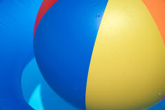 Floating tire and Beach Ball Royalty Free Stock Photography