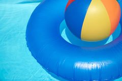 Floating tire and Beach Ball Royalty Free Stock Image