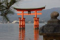 Floating torii gate. Red floating torii gate outside Itsukushima Shrine at Miyajima at low tide royalty free stock image