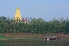 Floating Town and golden stupa in Kanchanaburi Thailand. Stock Image
