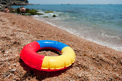 Floating toy at the beach Stock Image