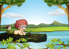 A floating trunk with a boy Stock Image
