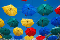 Floating umbrellas. Alley flying umbrellas. Colorful umbrellas in the sky. Fun and bright. Joy and happiness, salvation from the rain Stock Photo