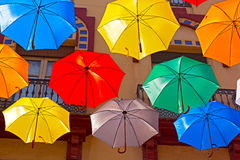 Floating umbrellas and city building on background. Stock Photos
