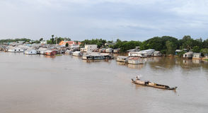 Floating Village And Fishing Boats Stock Photo