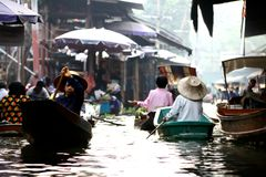 Floating village in Bangkok. Is located out of the city. It is touristic place,however lots of thai people live there and earn a living royalty free stock image