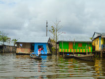 Floating village of Belen in Peru. Unidentified man at floating village of Belen in Peru. Belen is located in the floodplain of the Itaya River and consists of stock photos