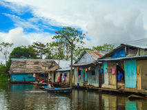 Floating village of Belen in Peru. Unidentified people at floating village of Belen in Peru. Belen is located in the floodplain of the Itaya River and consists royalty free stock images