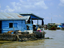 Floating village. Blue house on the water stock photography