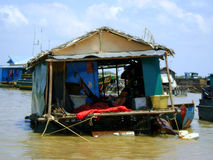 Floating village. Boat house on the water Royalty Free Stock Images