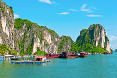 Floating village and boats. In Halong Bay, Vietnam, Southeast Asia royalty free stock photography