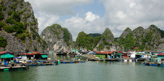 Floating village, Ha Long Bay. Ha Long Bay, Vietnam on a calm cloudy day Royalty Free Stock Image