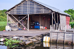 Floating village house near Siem Reap in Cambodia.  Stock Photos