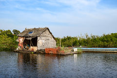 Floating village house near Siem Reap in Cambodia. Floating village houses near Siem Reap in Cambodia. The houses are relocated a few times each year to gain stock photo