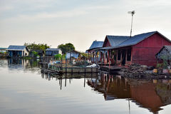 Floating village houses near Siem Reap in Cambodia. The houses are relocated a few times each year to gain optimal weather. Transport is by small boats, some stock photo