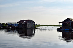 Floating village houses near Siem Reap in Cambodia. The houses are relocated a few times each year to gain optimal weather. Transport is by small boats, some royalty free stock photography