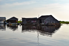 Floating village houses near Siem Reap in Cambodia. The houses are relocated a few times each year to gain optimal weather. Transport is by small boats, some stock image