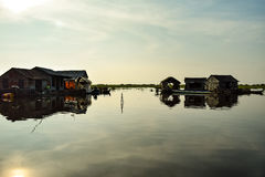 Floating village houses near Siem Reap in Cambodia. The houses are relocated a few times each year to gain optimal weather. Transport is by small boats, some stock photos