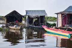 Floating village houses near Siem Reap in Cambodia. The houses are relocated a few times each year to gain optimal weather. Transport is by small boats, some stock images