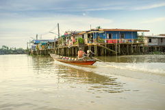 Floating Village. Houses raised on stilts on river mouth Stock Photos