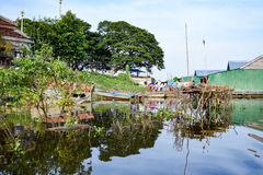 The floating village meets the bank of the floating village. The floating village is loacted near the community area on land (at left Stock Images