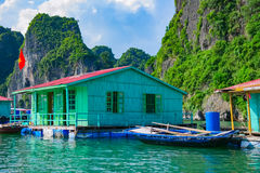 Floating village near rock islands in Halong Bay stock photography
