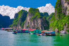 Floating village near rock islands in Halong Bay, Vietnam Stock Photography