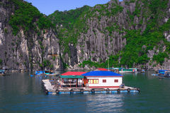 Floating village, rock island, Halong Bay, Vietnam. Floating fishing village and rock islands in Halong Bay, Vietnam, Southeast Asia. UNESCO World Heritage Site Royalty Free Stock Photo