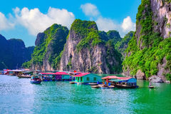 Floating village, rock island, Halong Bay, Vietnam. Floating fishing village rock island in Halong Bay Vietnam, Southeast Asia. UNESCO World Heritage Site. Junk Stock Photo