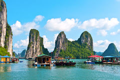 Floating village and rock islands. In Halong Bay, Vietnam, Southeast Asia royalty free stock photography
