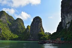 Floating village and rock islands in Halong Bay, Vietnam, Southeast Asia.  royalty free stock photos