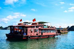 Floating village and rock islands in Halong Bay, Vietnam, Southeast Asia Stock Images