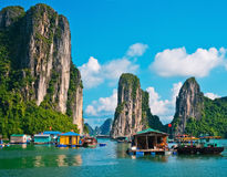 Floating village and rock islands in Halong Bay Royalty Free Stock Photography