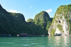 Floating village and rock islands in Halong Bay, Vietnam, Southeast Asia. Travel destination and natural background stock photo