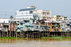 Floating village and selling motorboat on Bassac river Royalty Free Stock Photos