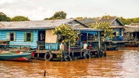 A  floating village on Tonle Sap lake. Tonle Sap Lake Siem Reap, Cambodia - July 13, 2013: Cambodian people live on Tonle Sap Lake in Siem Reap, Cambodia. The Stock Image