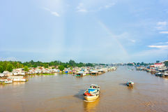 Floating village and transport boat on river, Mekong Delta Royalty Free Stock Photo