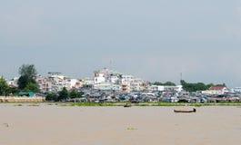 Floating village and transport boat on river Stock Images