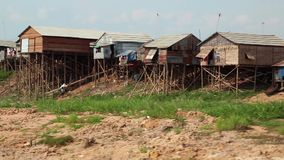 Floating village of Vietnamese refugees on Tonle Sap lake in Cambodia stock video footage