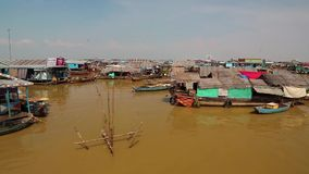 Floating village of Vietnamese refugees on Tonle Sap lake in Siem Reap, Cambodia. CAMBODIA, SIEM REAP PROVINCE, TONLE SAP LAKE, APRIL 3, 2014: Floating village stock video footage