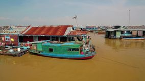 Floating village of Vietnamese refugees on Tonle Sap lake in Siem Reap, Cambodia Royalty Free Stock Images
