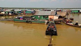 Floating village of Vietnamese refugees on Tonle Sap lake in Siem Reap, Cambodia. CAMBODIA, SIEM REAP PROVINCE, TONLE SAP LAKE, APRIL 3, 2014: Floating village stock footage
