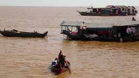 Floating village of Vietnamese refugees on Tonle Sap lake in Siem Reap, Cambodia stock video footage