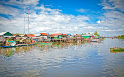 The floating village on the water, Tonle Sap lake. Cambodia. Stock Photos