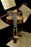 Floating violin and notation sheets Royalty Free Stock Photos