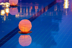 Floating water lantern in the pool Royalty Free Stock Photos