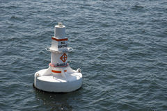 Floating white buoy in the sea Stock Photo